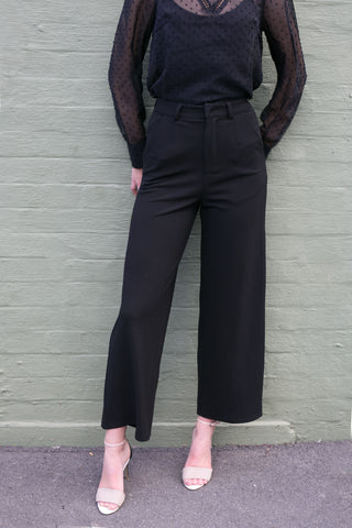 Front view of black high waisted wide leg work pants without detachable belt