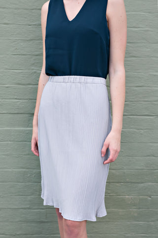 Front view of grey pleated midi work skirt
