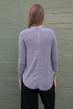 Back view of grey long sleeve choker style v neck work knit top