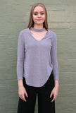 Front view of grey long sleeve choker style v neck work knit top