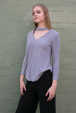 Side view of grey long sleeve choker style v neck work knit top