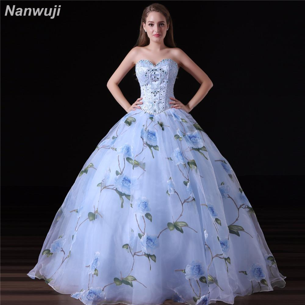 08fa7b57755 Hover to zoom · 2018 Hot Sale Ball Gown Quinceanera Dresses Long Blue Tulle  Appliques Beaded Cap Sleeves Puffy Sweet
