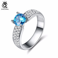 ORSA JEWELS Luxury Engagement Rings with 0.8 Carat Round Shape Ocean Blue AAA Cubic Zirconia for Women Fashion Jewelry OR144