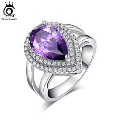 ORSA JEWELS Big Water Drop 6 ct Zircon Ring 3 Prong Setting with Micro Paved CZ Stone Around Trendy Party Rings for Women OR36
