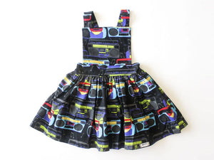 Girls pinafore dress in Boombox print.  Unique kids clothing by Worthy Threads clothing brand, available in matching sibling outfits!