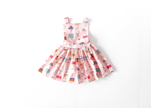 Girls pinafore dress in pink with cakes print