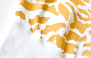 Close up of hand painted tiger print hoodie