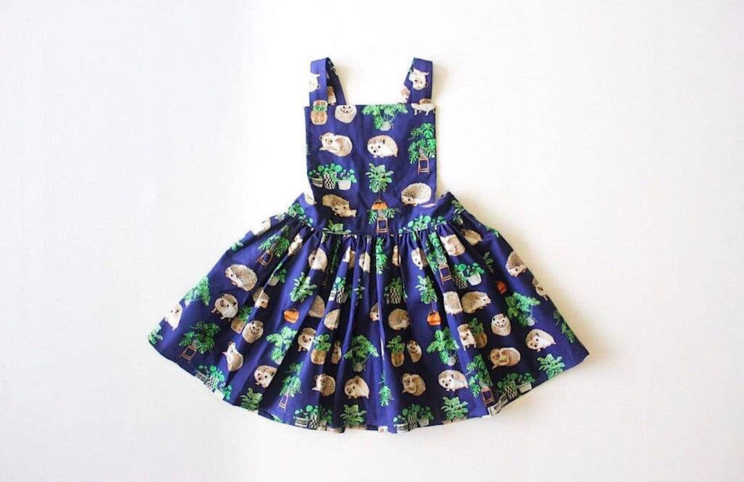 Girls pinafore dress in Hedgehog print.  Unique kids clothing for your tiny individual.  Perfect matching sister outfits newborn and toddler!