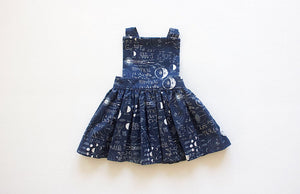 STEM clothing: Girls pinafore dress in STEM print.  Unique kids clothing, math and science clothes for kids, available in matching sibling outfits!