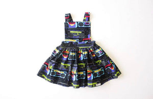 Girls pinafore dress in boombox print.  Unique kids clothing for your tiny individual. Perfect for matching sister outfits newborn and toddler!