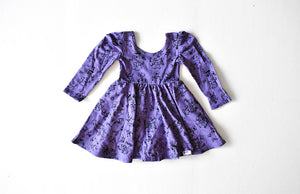 Twirly dress featuring Robots in purple.  STEM clothing for girls!