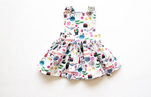 Unique kids clothes- girls pinafore dress in sushi print by Worthy Threads clothing brand
