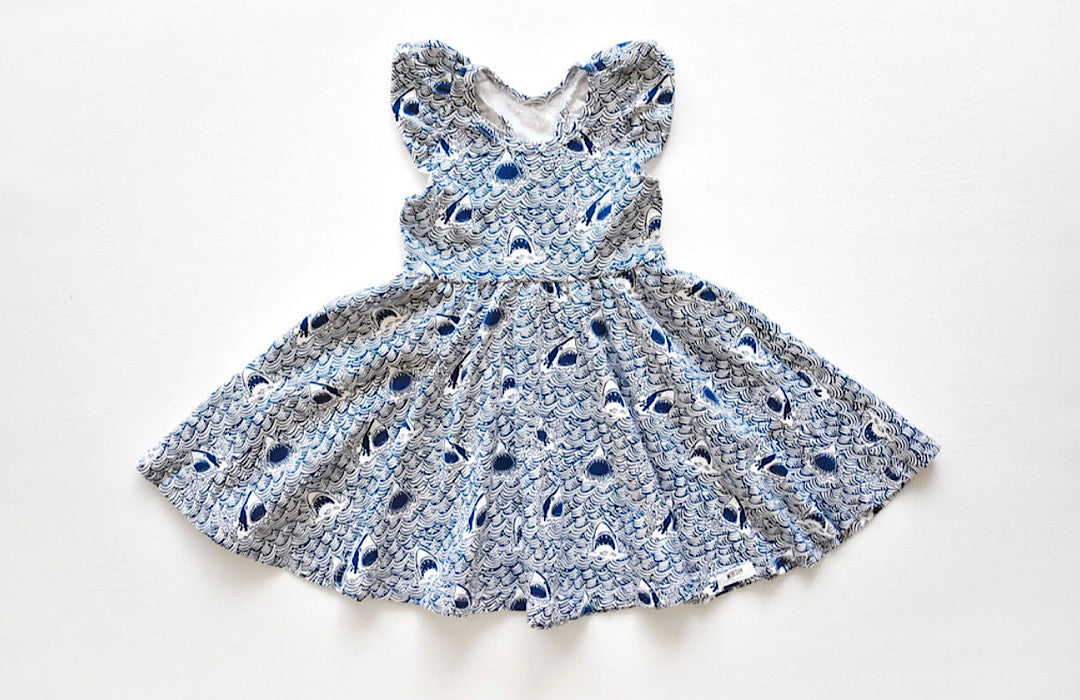 Ruffle twirly dress in sharks print: unique kids clothing by worthy threads brand