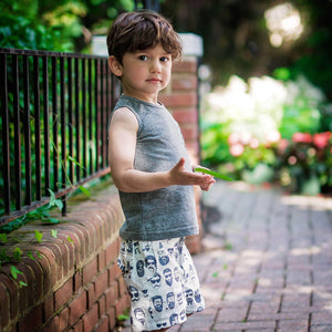 hipster boy looking at camera in beatnik shorts and tank.  Matching sibling outfits available!