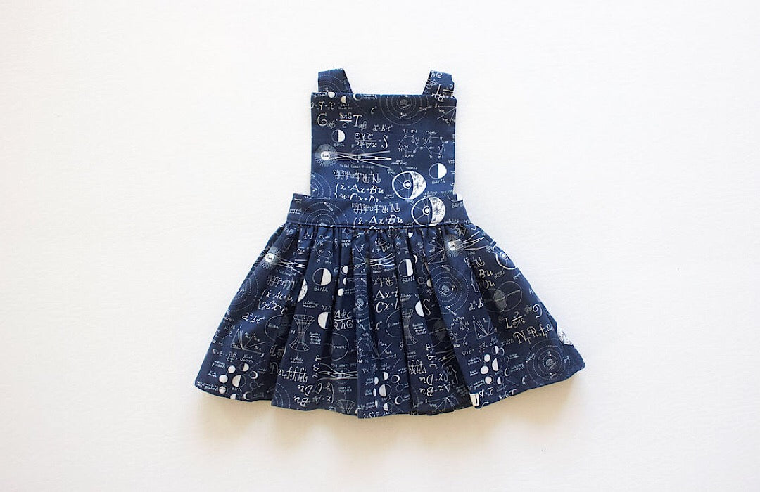 STEM clothing: Baby and toddler pinafore dress in STEM print.  Unique baby clothing, math and science clothes for kids, available in matching sibling outfits!