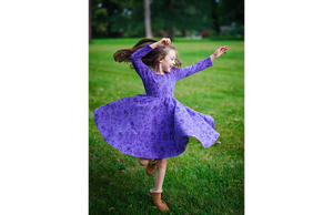 Girl spinning in robots twirly purple dress: stem clothing for girls