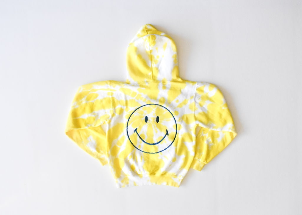 Kids tie dye hoodie in yellow with embroidered smiley face on back