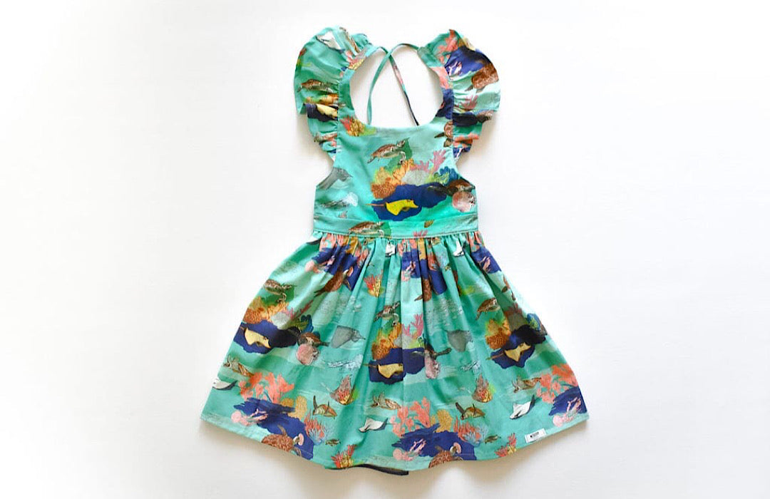 Ruffle dress in Under the Sea fabric by Worthy Threads clothing brand