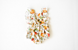 Back view of bubble romper in cheese print: unique baby clothes