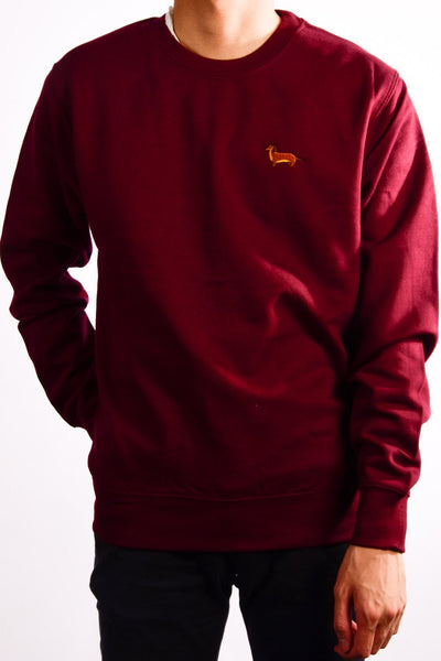 embroidered dachshund logo on burgundy jumper