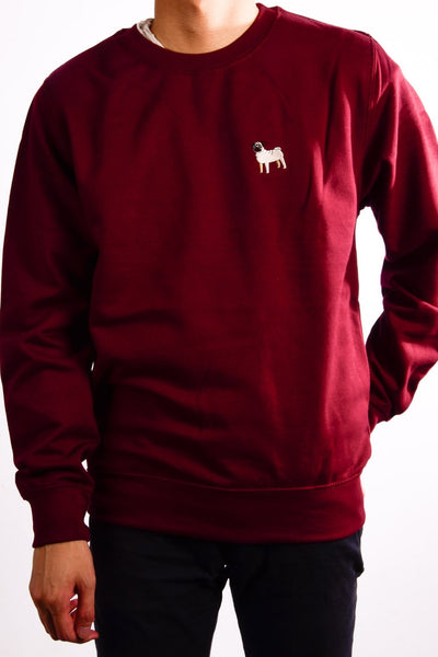 embroidered pug logo on burgundy jumper
