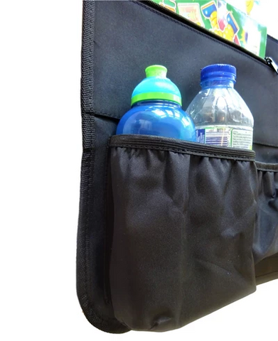 Close up of car organiser for kids showing two bottles in an elasticated pocket