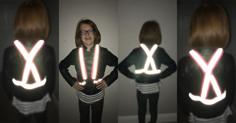 Girl wearing high vis reflective sash