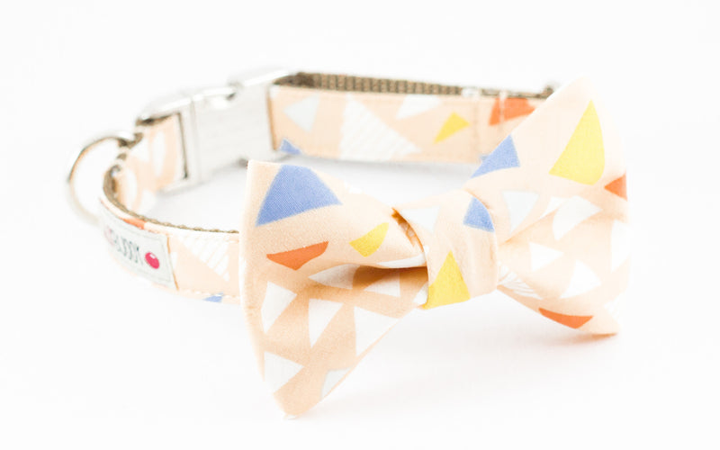 Pastel peach triangle print dog bowtie collar.