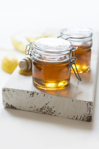 raw honey in glass containers