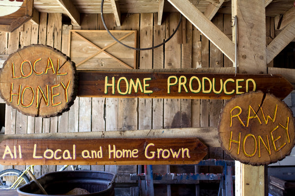 sign advertising local raw honey