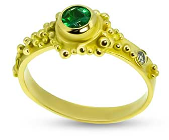 Emerald re-set into granulated ring