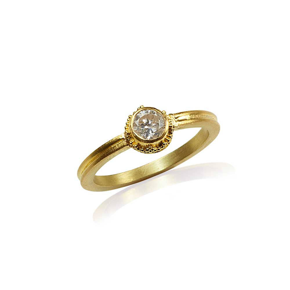 Granulation in 22k gold diamond engagement ring