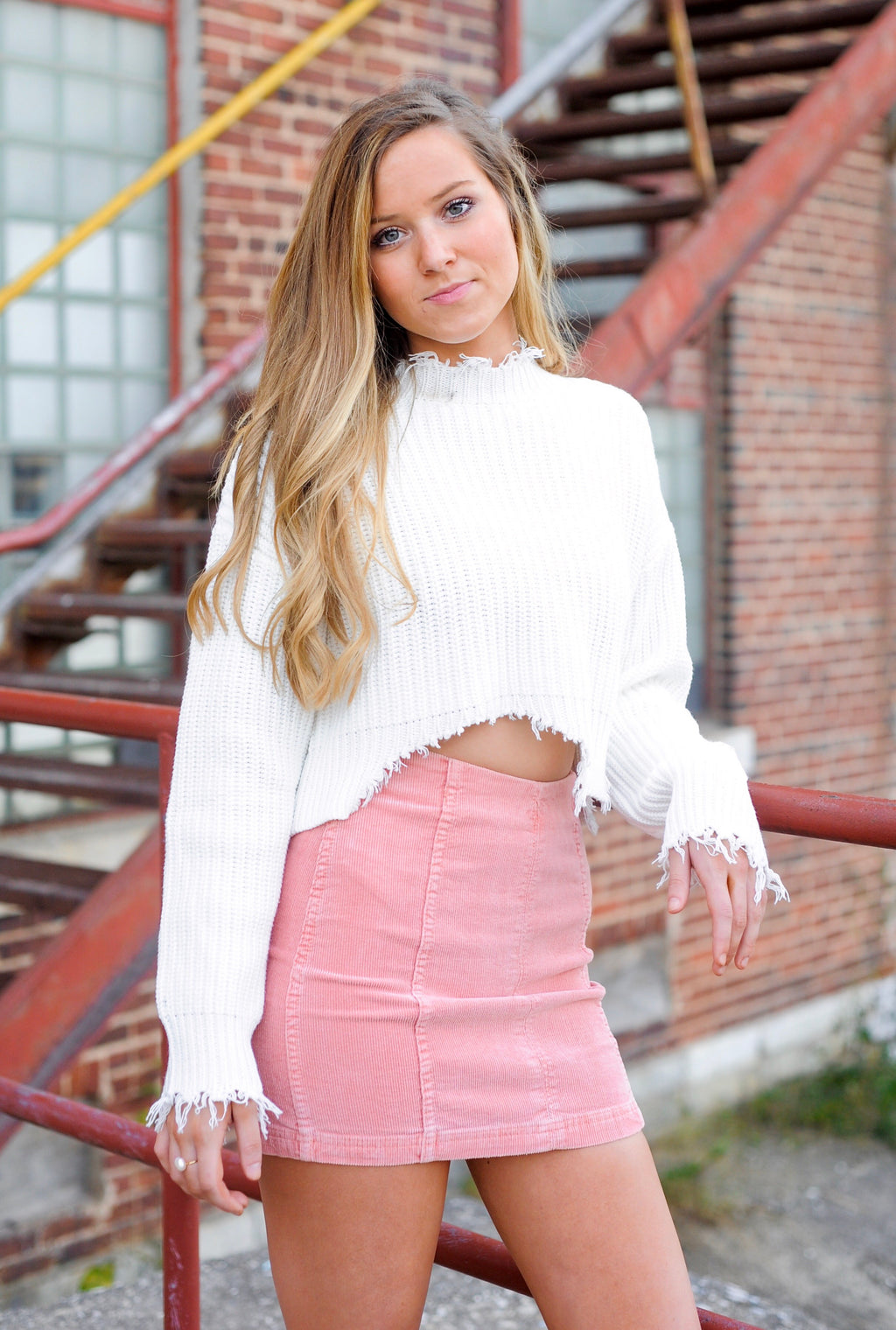 Soft Pink corduroy skirt with white crop top distressed sweater