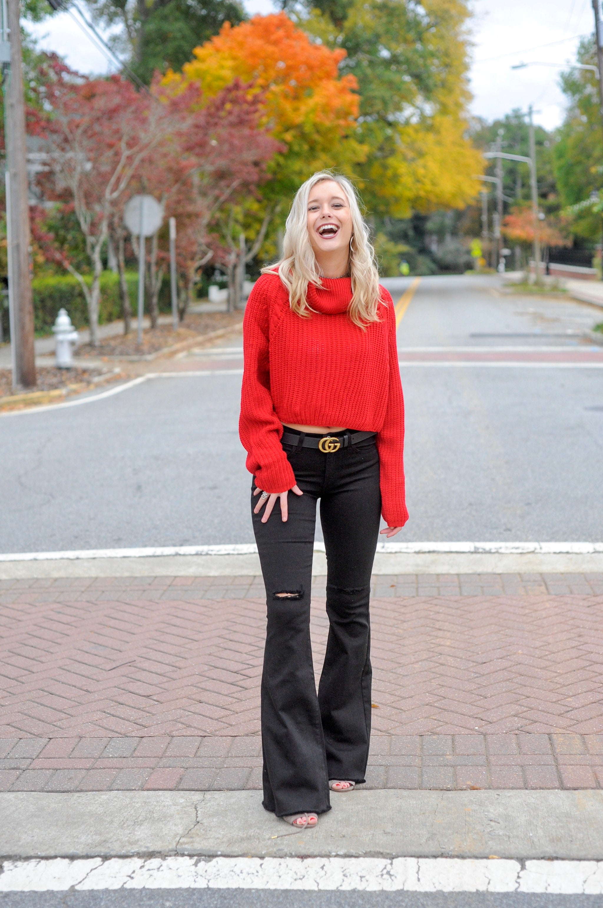 Red Cropped Turtle neck Sweater with black bell bottom pants