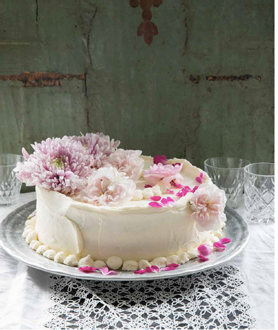 Cake beautiful from Violet Cakes in London: fresh pink flowers atop an imperfectly lovely homemade cake by Clare Ptak. #Violetcakes #cakedecorating #pink