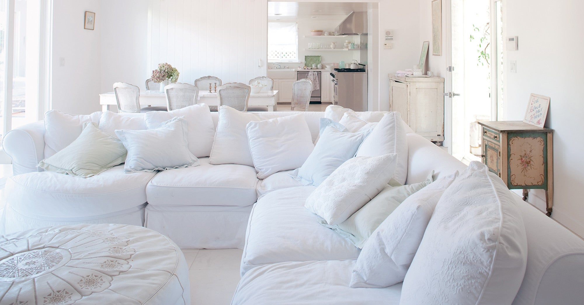 Shabby Chic Decor finds await you in this inspiring lineup of interior design inspiration. #shabbychic #interiordesignideas #decoratingideas #rachelashwell #sectional #livingroom #slipcovered