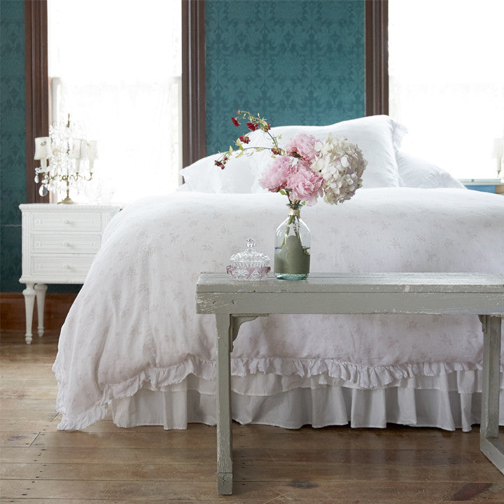 Shabby chic bedroom with teal wall, wood bench, and Rosabelle Bedding Collection from Shabby Chic by Rachel Ashwell. #shabbychic #teal #bedroomdecor