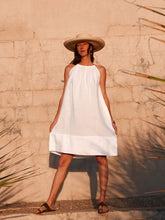 Model against wall wearing natural linen Summer Dress