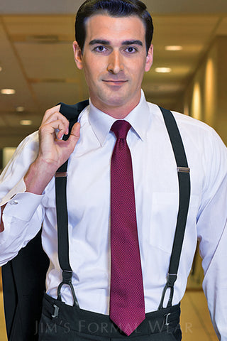 business man wearing suspenders and a suit
