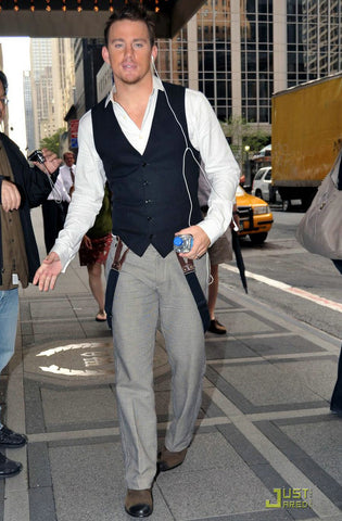 channing tatum wearing a vest and suspenders hanging down