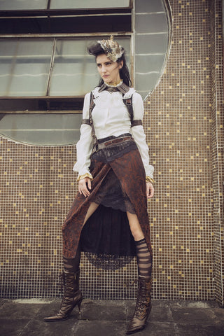 girl in steampunk suspenders costume