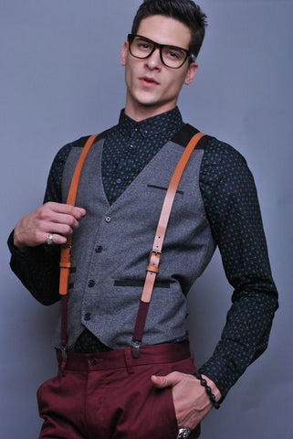guy wearing leather suspenders with a vest