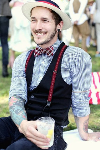 hipster wearing suspenders with a vest