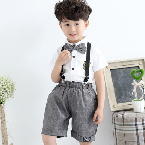 kid wearing shorts and suspenders