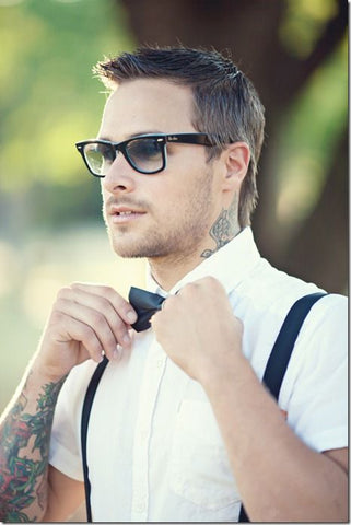 man adjusting his bow tie