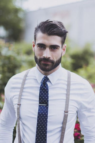 man in blue tie and suspenders