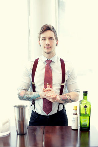 man in matching red tie and suspenders