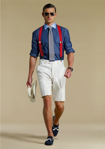 man wearing suspenders with shorts