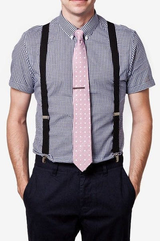pink tie and black suspenders
