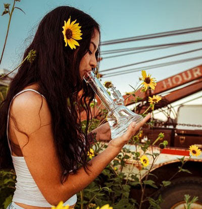 Girl using a water pipe on the 420 holiday